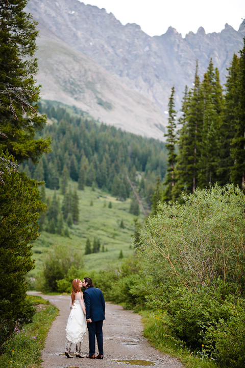 Bride and groom at a remote destination mountain elopement location in the mountains
