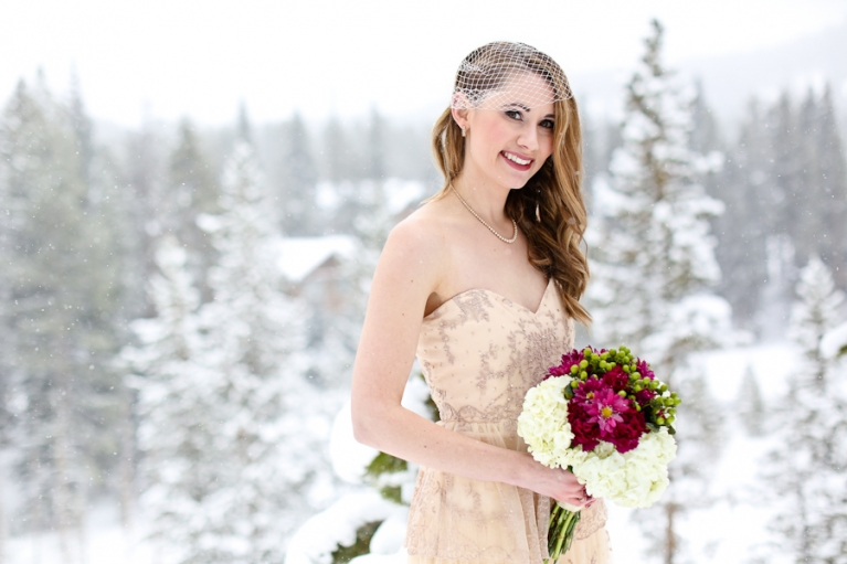 Bride eloping in the winter mountains
