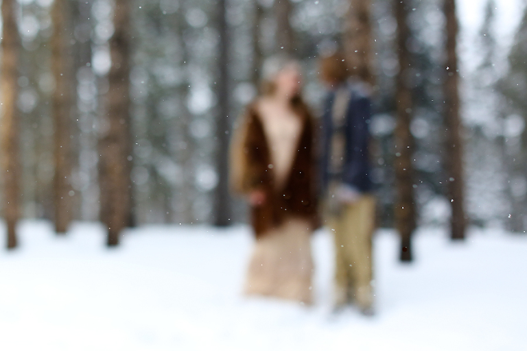 bride and groom eloping in the falling snow in colorado