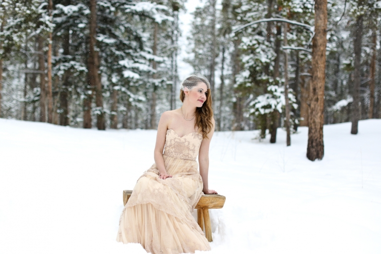 bride in a snowy forest