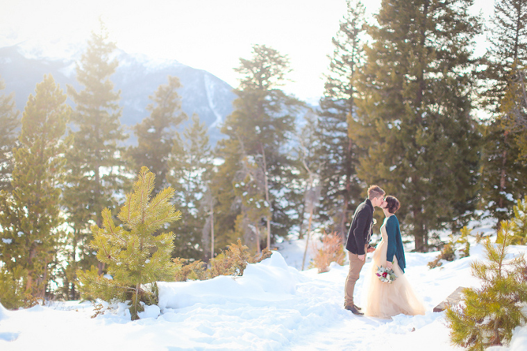 A winter elopement in colorado with a snowy forest backdrop