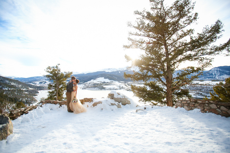 bride and groom eloping in the winter at sapphire point with snow on the ground