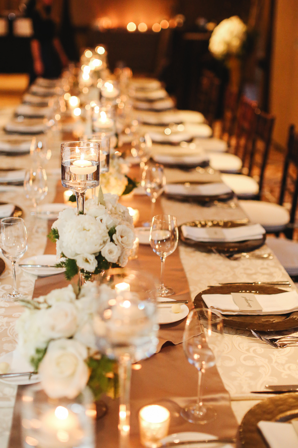 luxury lodge for a winter wedding reception with white florals and candles