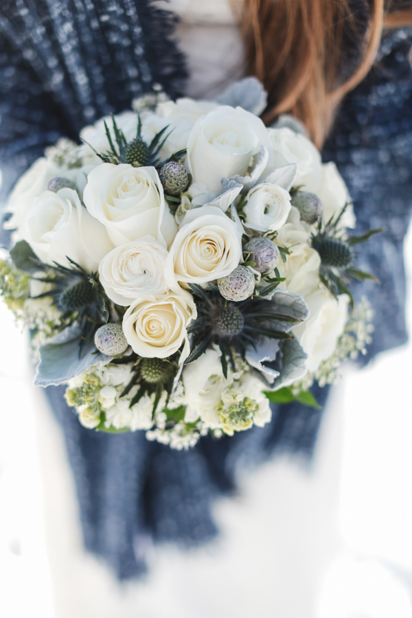 Winter elopement bouquet with dusty miller and thistles