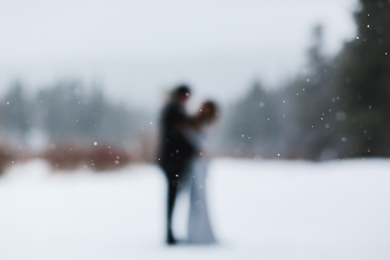 winter elopement ceremony in colorado with lots of snow falling