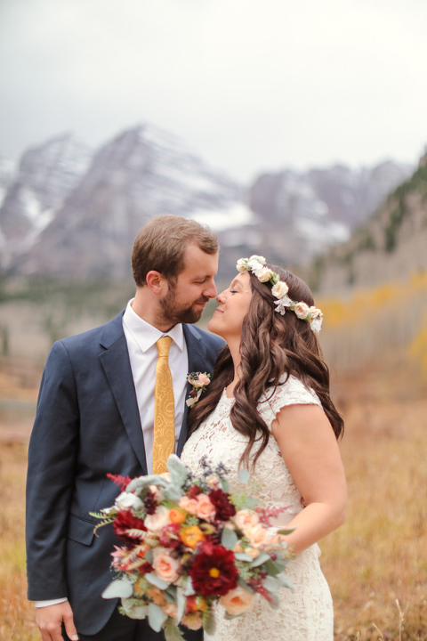 Colorado elopement location the maroon bells in aspen colorado with a bride and groom in wedding attire