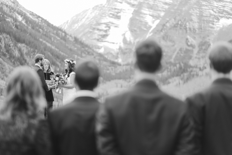 An intimate wedding takes place at the maroon bells amphitheater during a family-only elopement