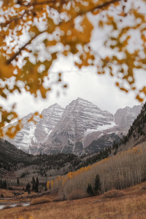 The maroon bells in early october with just a few leaves still left on the aspen trees