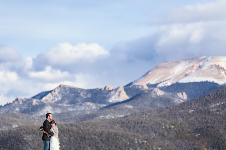 incredible views from a wintertime elopement in the rocky mountains of colorado behind Pike's peak in december