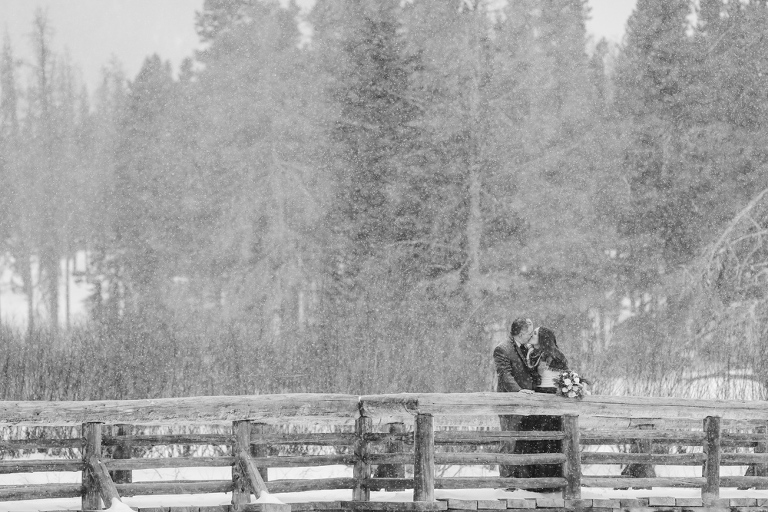 Eloping in a blizzard in the Colorado Mountains of Rocky Mountain National Park at Sprague Lake in the winter