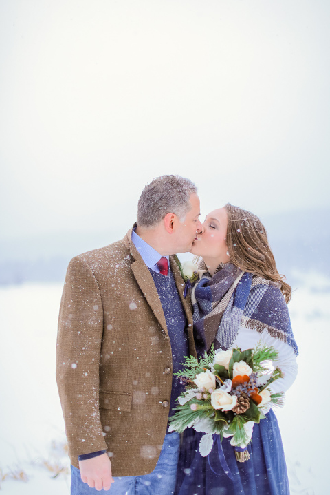 Self-solemnized winter elopement in December in Rocky Mountain National Park. Photographed by Becky Young