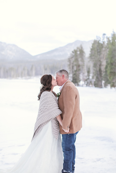 bride and groom eloping in the snowy mountains and forests of colorado
