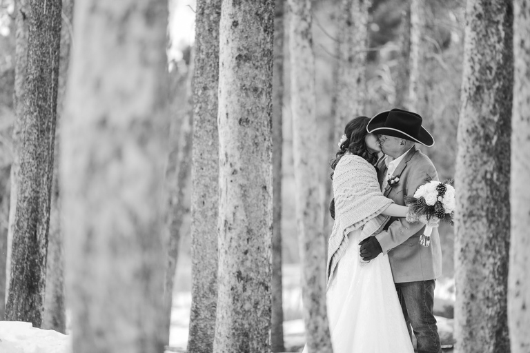 groom in cowboy hat eloping in the winter