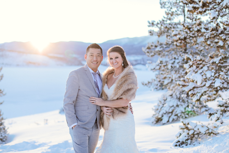 Couple elopes on the lakeshore of Lake Dillon in Colorado during the winter