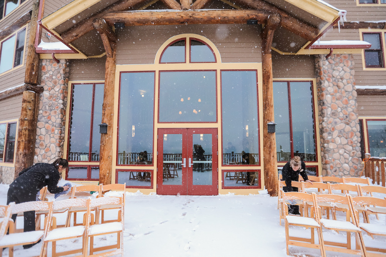 the deck at The Lodge at Breckenridge covered in snow during a winter wedding ceremony