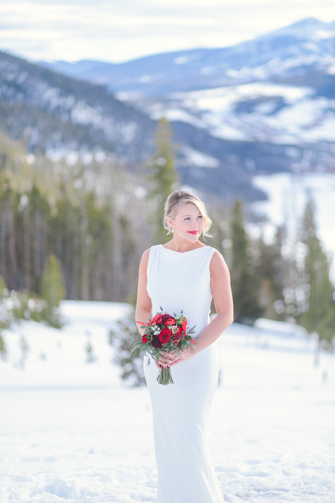 Bride eloping in the snowy mountains of Breckenridge Colorado in February
