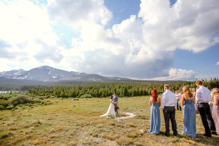 An intimate wedding in a mountain meadow makes a great backdrop for an alpine elopement